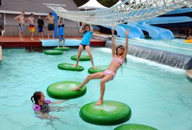 Park-goers navigate across the Lilly Pads at the Water Wizz water park in Wareham.