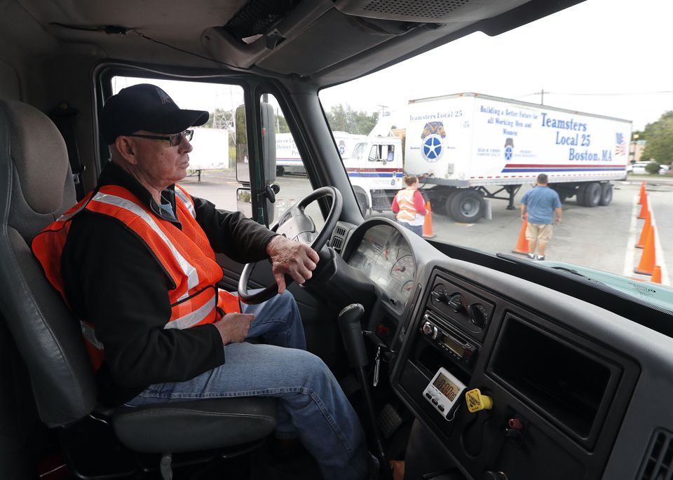 Mike Powers of Salisbury practices driving a truck at the Teamsters Local 25 truck driving school in Tewksbury.