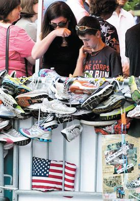 Denise Richard, who was injured in the Marathon bombings and whose son Martin was among three killed, viewed the memorial Monday alongside her surviving son, Henry.