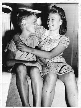 """Eight-year-old """"Sonny"""" Downs and his 11-year-old sister, Lucille, in 1942."""