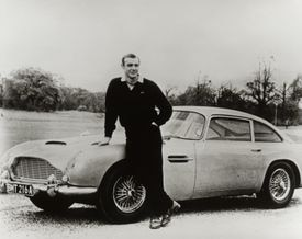 """In the soon-to-be released James Bond film, """"Spectre,"""" an Aston Martin (below) will again be the mode of transportation for agent 007, played first by Sean Connery (above, in 1964's """"Goldfinger"""") and most recently by Daniel Craig."""