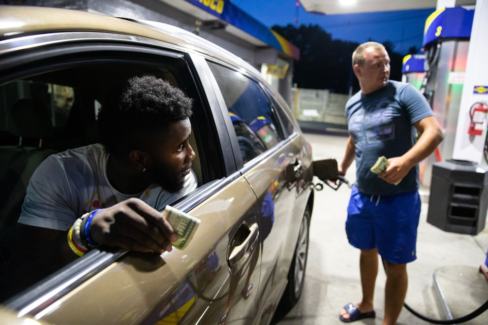 At Elliot Sunoco Service in Newton, business boomed after management lowered prices for cash customers.