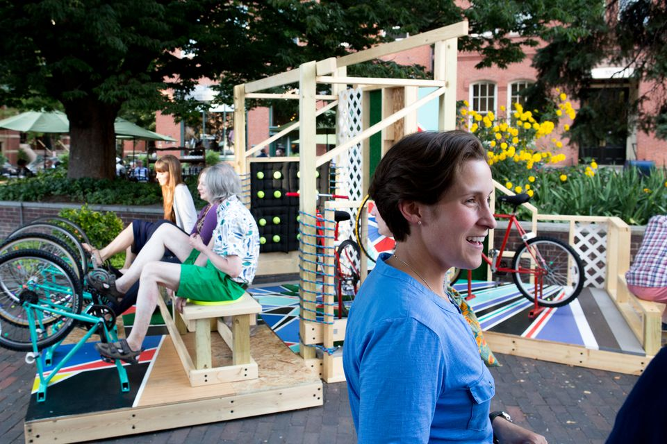 """Amy Archambault in front of her installation """"InMotion: Memories of Invented Play."""""""