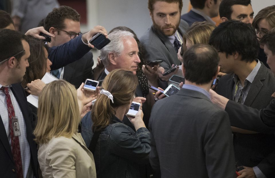 Senate Foreign Relations Committee Chairman Bob Corker was surrounded by reporters looking for a reaction to President Trump's meeting with Russian officials.