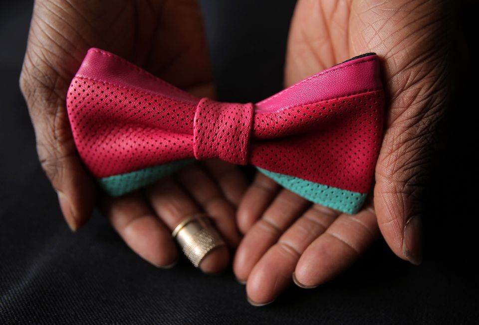 Christopher Chaun Bennett makes high-end bow ties in the bedroom of his apartment.