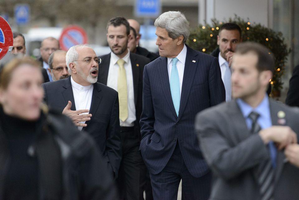 US Secretary of State John Kerry, right, walks in Geneva with Iranian Foreign Minister Mohammad Javad Zarif on Jan. 14.