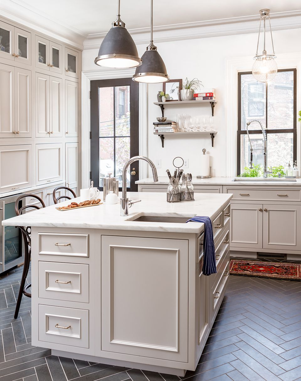 The Candlelight Cabinetry kitchen cabinets, from Boston Building Resources, are a custom putty color that changes from white to beige to gray depending on the time of day.