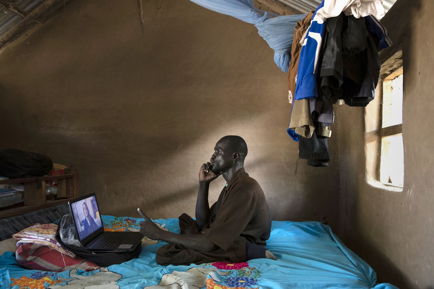 Bol Daniel Maduk, did his class work in the compound where he lives in the UNHCR refugee camp in Kakuma. Maduk hopes that the degree he is working on through Southern New Hampshire University's online program will enable him to start his own school for children with special needs.