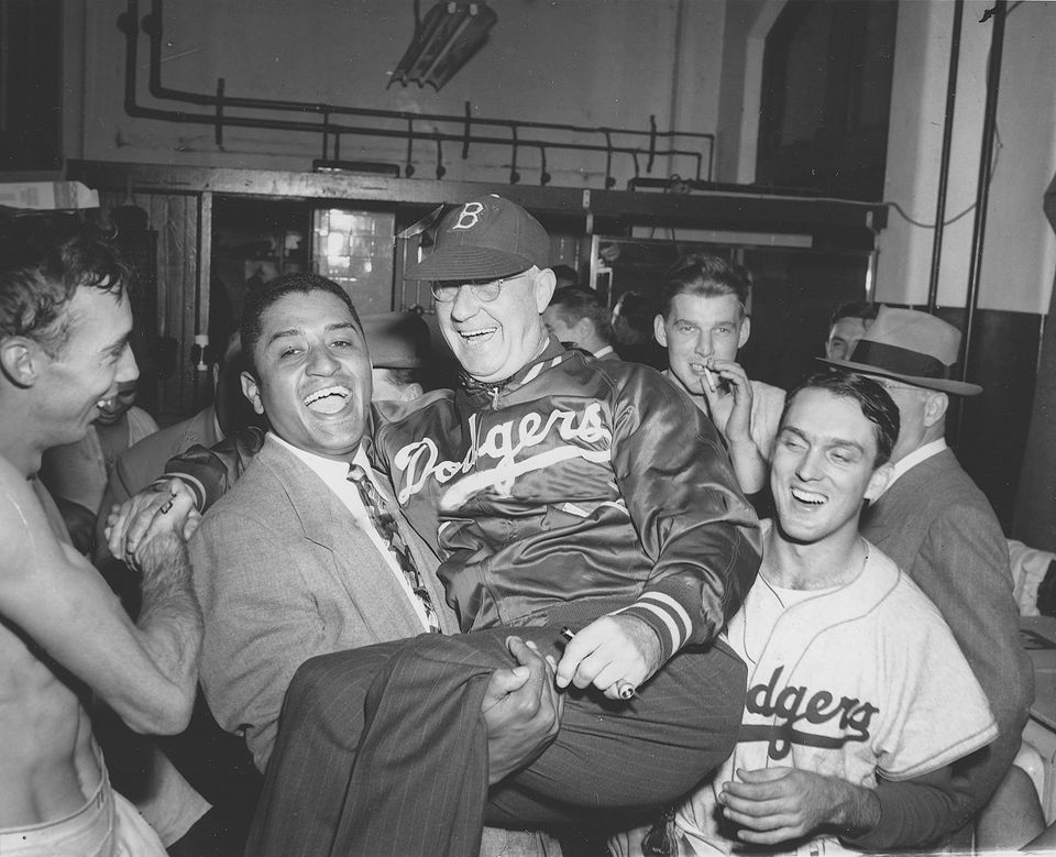 Mr. Newcombe held up Dodgers manager Burt Shotton after the team won the 1949 National League pennant against the Philadelphia Phillies.