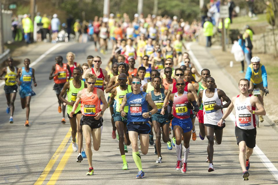 Elite runners, including Ryan Hall and Keflezighi, race during the 2014 Boston Marathon.