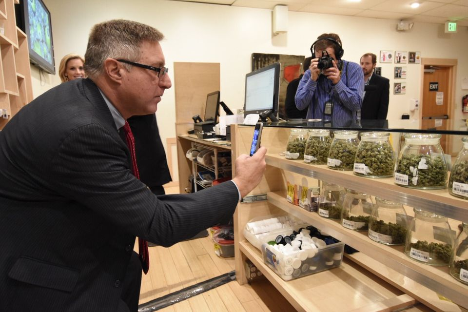 Massachusetts state Senator Michael J. Rodrigues snapped a photo at RiverRock Cannabis in Denver on Tuesday.