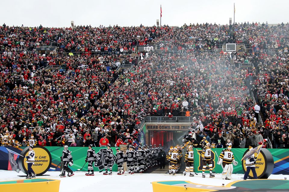 The Blackhawks and Bruins entered the field at Notre Dame Stadium.
