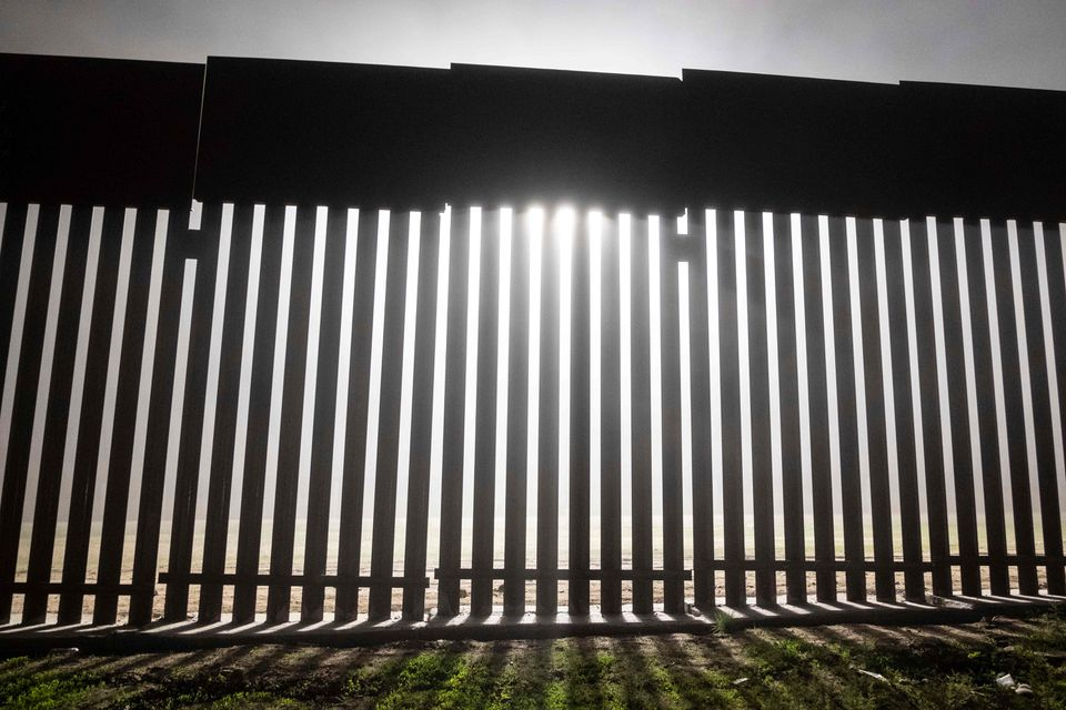 A reinforced section of the border fence separates Mexico from the United States at Tijuana, Mexico.