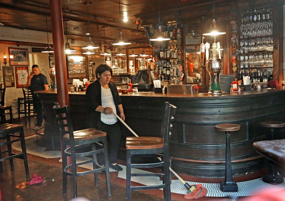A worker cleaned the Union Oyster House on Friday.