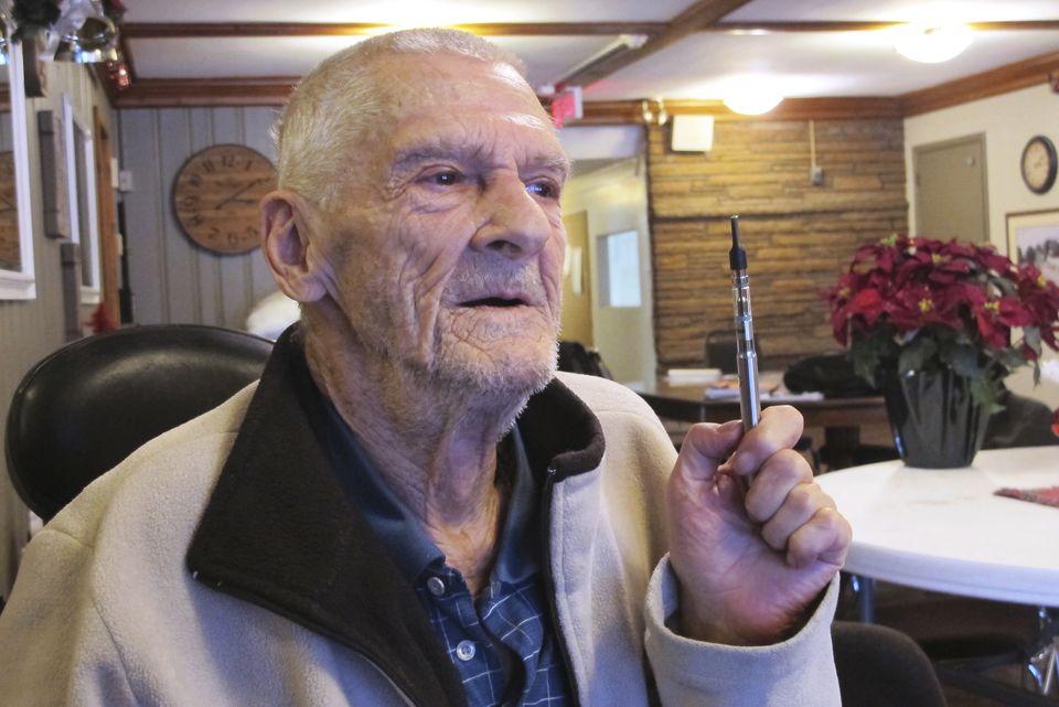 John Flickner, 78, held his medical marijuana vaporizer Friday. He's staying at a homeless shelter after being evicted for using medical marijuana inside his federal subsidized apartment.