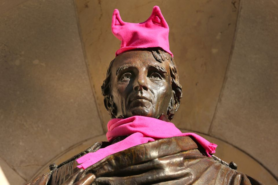 Someone adorned the statue of William Ellery Channing with a pink knit hat and scarf.