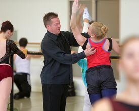 Mikko Nissinen (left) teaching company class: observing, complimenting, correcting.