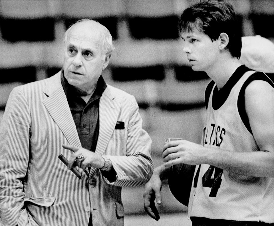 Ainge picking up a pointer from Red Auerbach In 1985. Auerbach won seven titles as a general manager, two with Ainge  as a player.