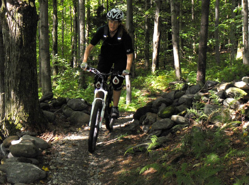 Darcy Cahill takes to the 12 miles of flowing trails, suited for novice and veteran mountain bikers, at the Trapp Family Lodge.