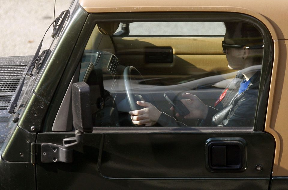 Massachusetts now has momentum towards joining 18 other states, including each of its immediate neighbors in outlawing drivers from using hand-held devices, except for in emergencies.