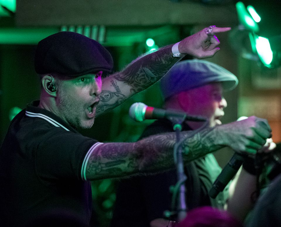 Barr (left) and Ken Casey of the Dropkick Murphys gave the Quincy mainstay a rousing sendoff.