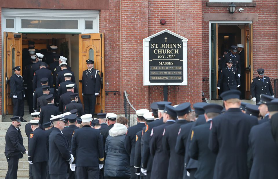 Firefighters did a walk-by Friday during the wake for Worcester Firefighter Christopher J. Roy at St. John's Catholic Church.