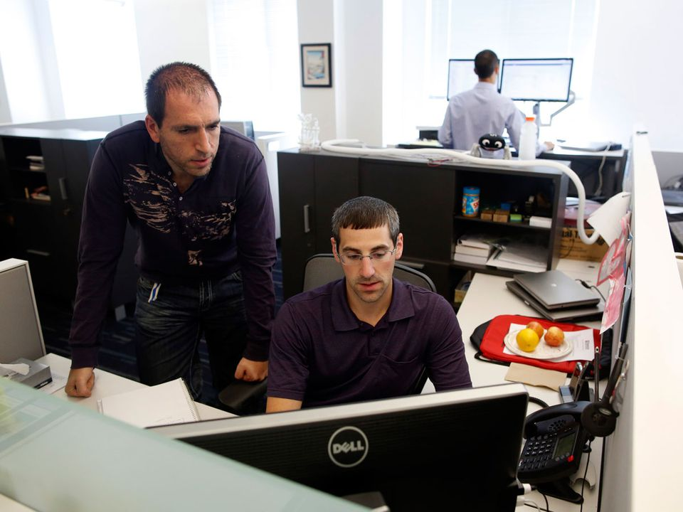 Mike Preshman (left) and Matt Manger at work at Veracode, where employees set their own vacations.