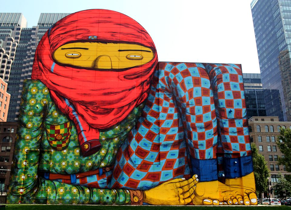 A new mural by Os Gemeos, a complement to their ICA show, covers the exterior wall of a giant air intake structure on the Rose F. Kennedy Greenway.