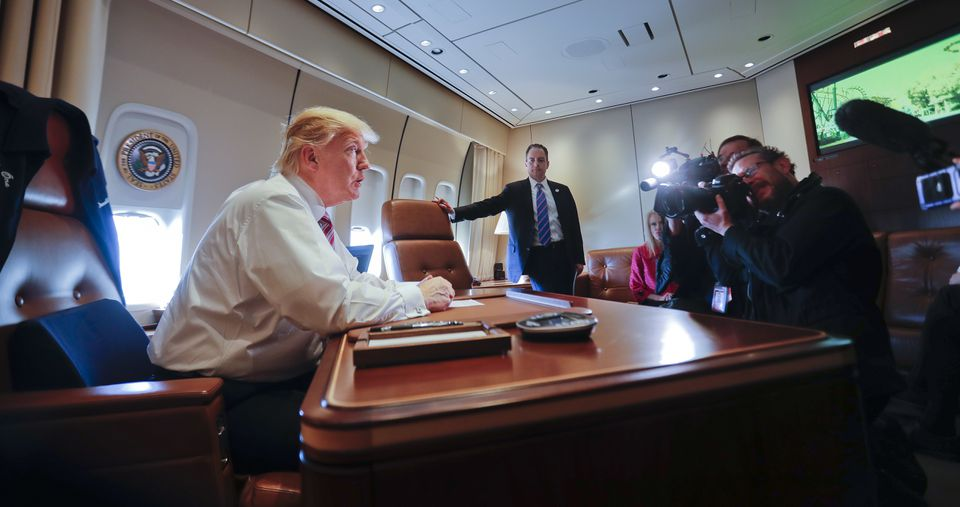 President Donald Trump sat his desk on Air Force One upon his arrival at Andrews Air Force Base Thursday.