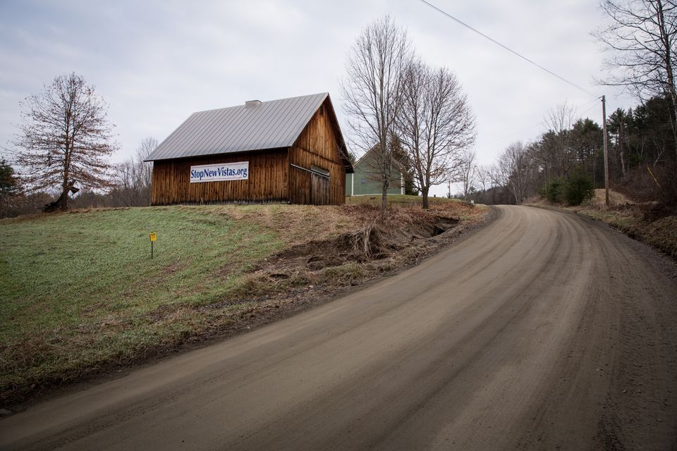 A banner hung on the side of a Tunbridge, Vt., barn opposes the proposed development.