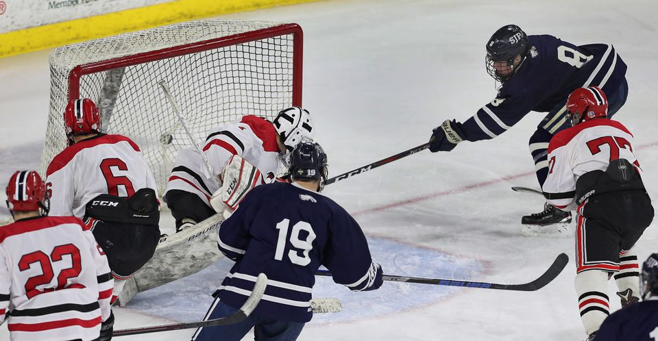 Patrick Moran (8) gave St. John's Prep its lone goal of the night when he beat Winchester goalie Robert DiVincenzo to tie the game at 1-1 in the second period.