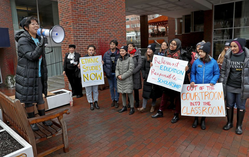 Harvard senior Sally Chen addressed a group of protesters outside of the Charles Hotel on Friday.