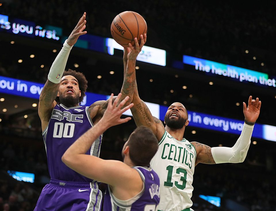 The Celtics' Marcus Morris battles the Kings' Willie Cauley-Stein for a rebound.