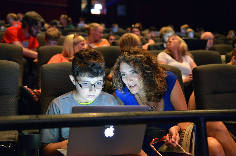 Chase Rubin, 10, and his mother Mary Rubin, of Boston had their eyes on the small screen.