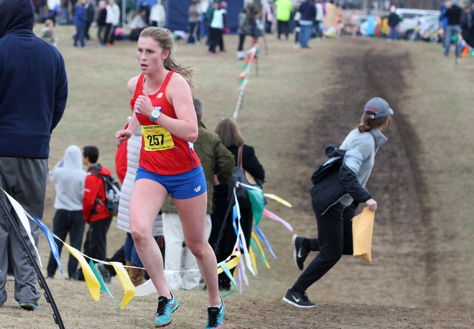 Natick's Grace Connolly was running all by herself by the 2-mile mark.