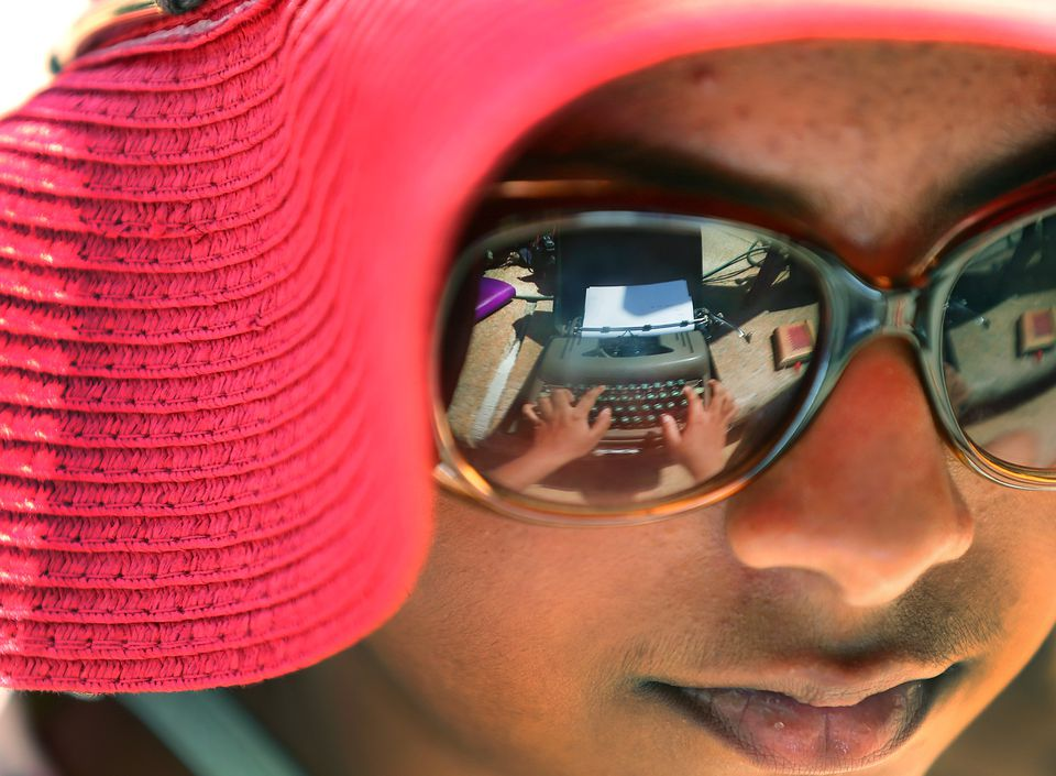 Mahiti Bapuji, 12, had the typewriter she was working on reflected in her glasses as she typed.
