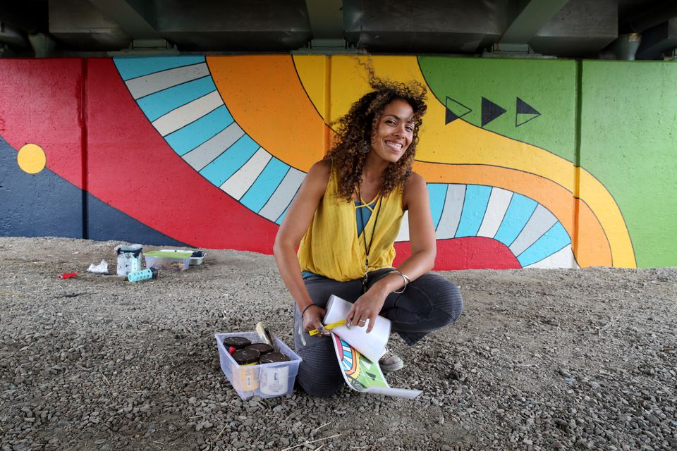 """Local artist Silvia López Chavez painted the mural """"Patterned Behavior"""" along the Paul Dudley White bike path on the Charles River Esplanade."""