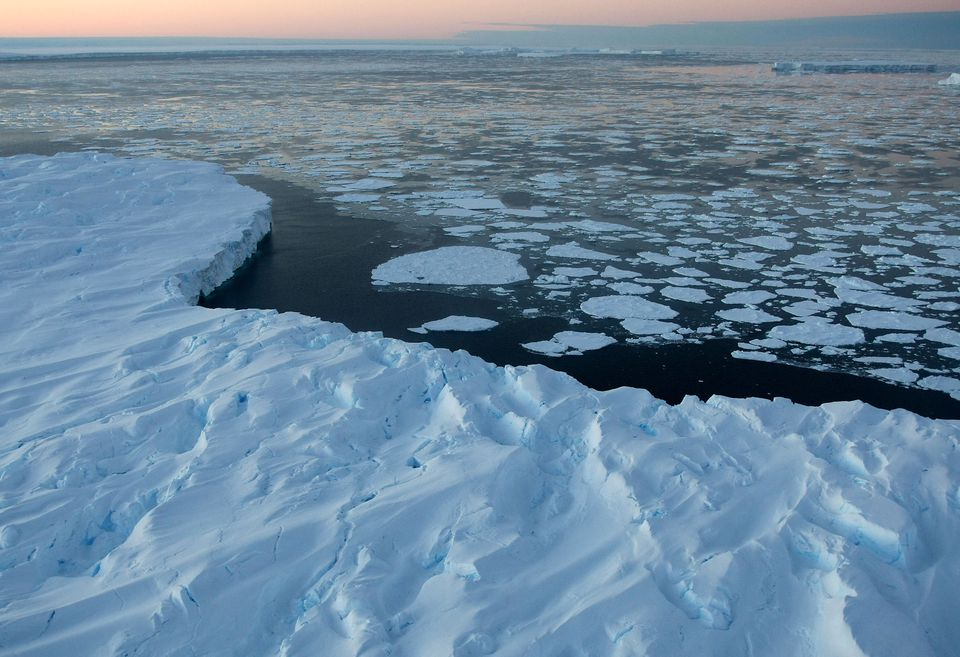 Giant tabular icebergs are surrounded by ice floe drift in Vincennes Bay, Jan. 11, 2008, in the Australian Antarctic Territory. Australia's CSIRO atmospheric research unit found the world is warming faster than predicted by the United Nations' top climate change body, with harmful emissions exceeding worst-case estimates.
