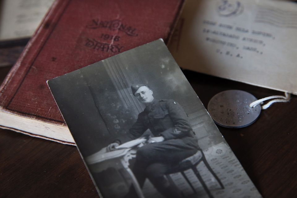 Anne Rodier displayed a photograph of her grandfather, Joe Rodier, along with his diary, dog tag, and a letter to her aunt, at her home in Kennebunk, Maine. Joe Rozier was a 24-year-old Massachusetts soldier in the US Army during World War I.