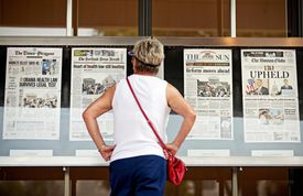 Joy Reynolds of San Diego inspected a display at the Newseum in Washington of newspaper coverage of the historic Supreme Court ruling on health care.