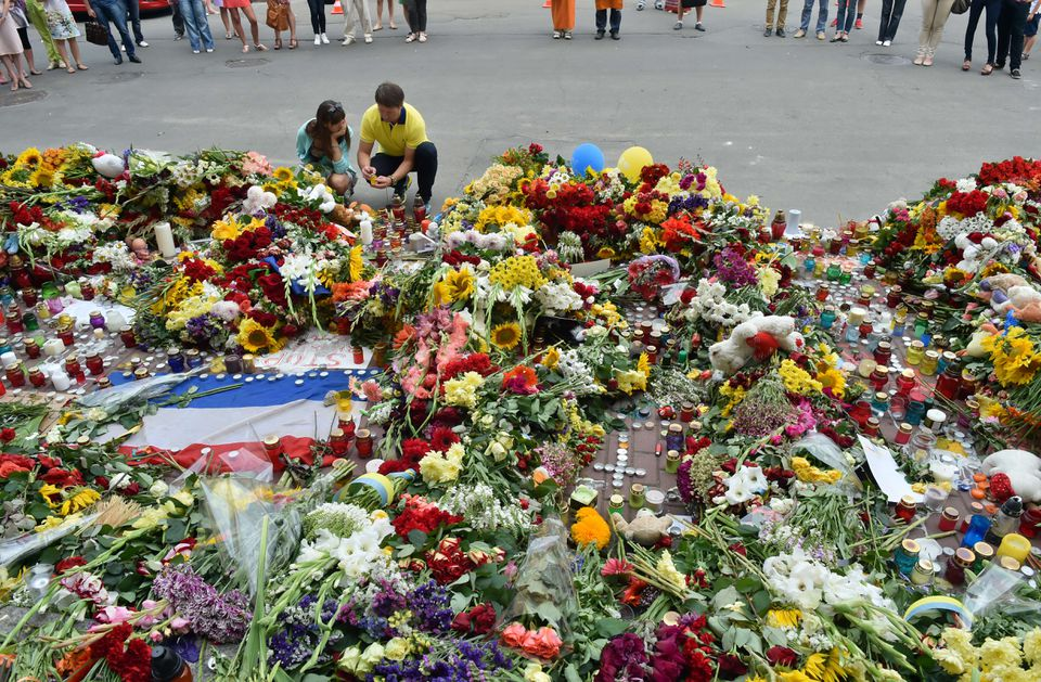 People laid flowers and lit candles in front of the Dutch Embassy in Kiev after the crash of the Malaysian jetliner.