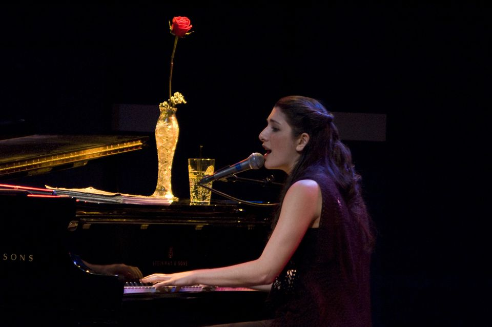 Kate Ferber performs most of her one-woman show at the piano.