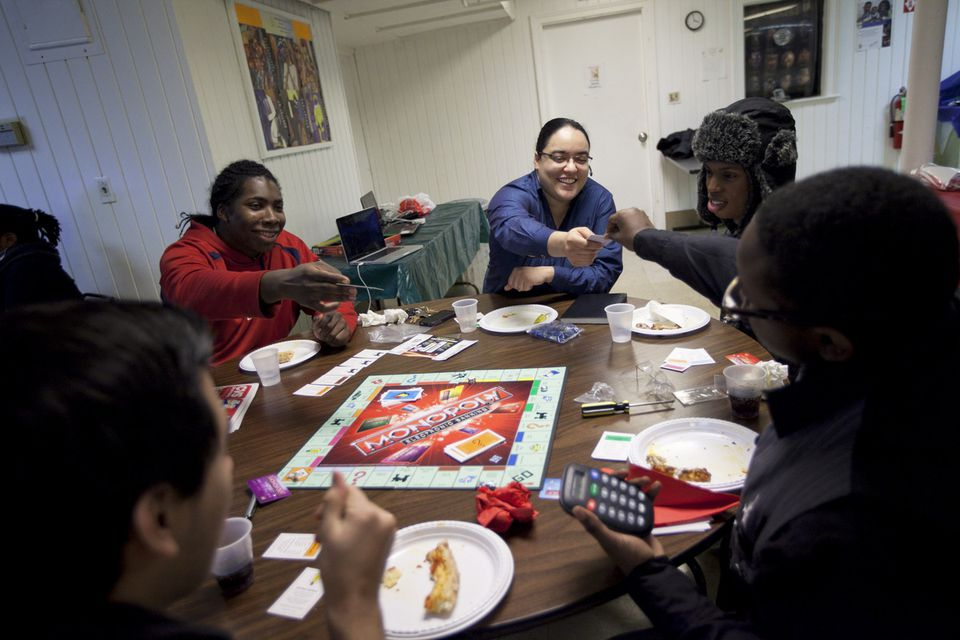The Rev. Catharine Cummings played Monopoly with a group of youths.