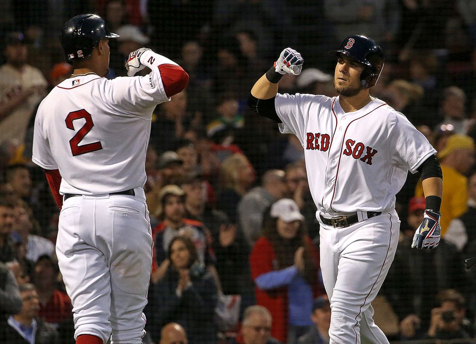 Red Sox rookie Michael Chavis is greeted by Xander Bogaerts after he blasted a 2-run homer in the second inning of Thursday night's game against the visiting Tigers at Fenway Park.