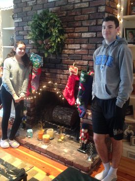 Holly and Tim West helped with the Christmas decorations at author Nancy Shohet West's home.