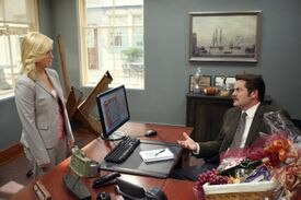 """PARKS AND RECREATION -- """"Boys' Club"""" Episode 104 -- Pictured: (l-r) Amy Poehler as Leslie Knope, Nick Offerman as Ron Swanson -- NBC Photo: Justin Lubin 03tvpregnant"""