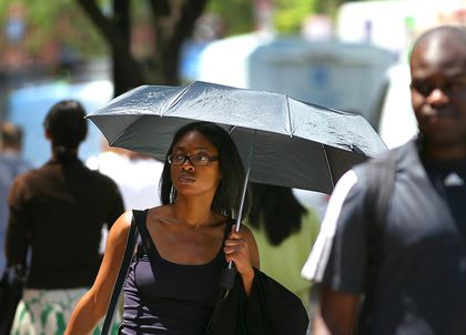 Parasols become trendy - The Boston Globe