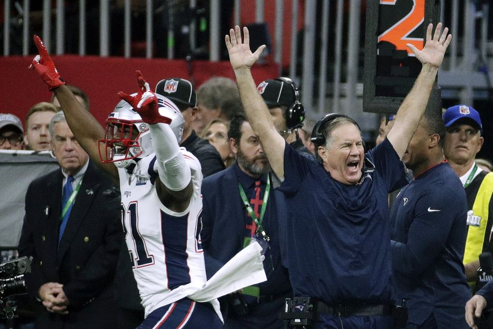 Harmon and coach Bill Belichick celebrating the victory on the field Sunday night