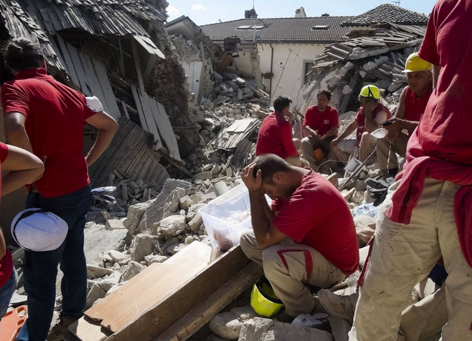 Rescuers paused in Amatrice, ceItaly, where a 6.1 earthquake struck Wednesday morning.