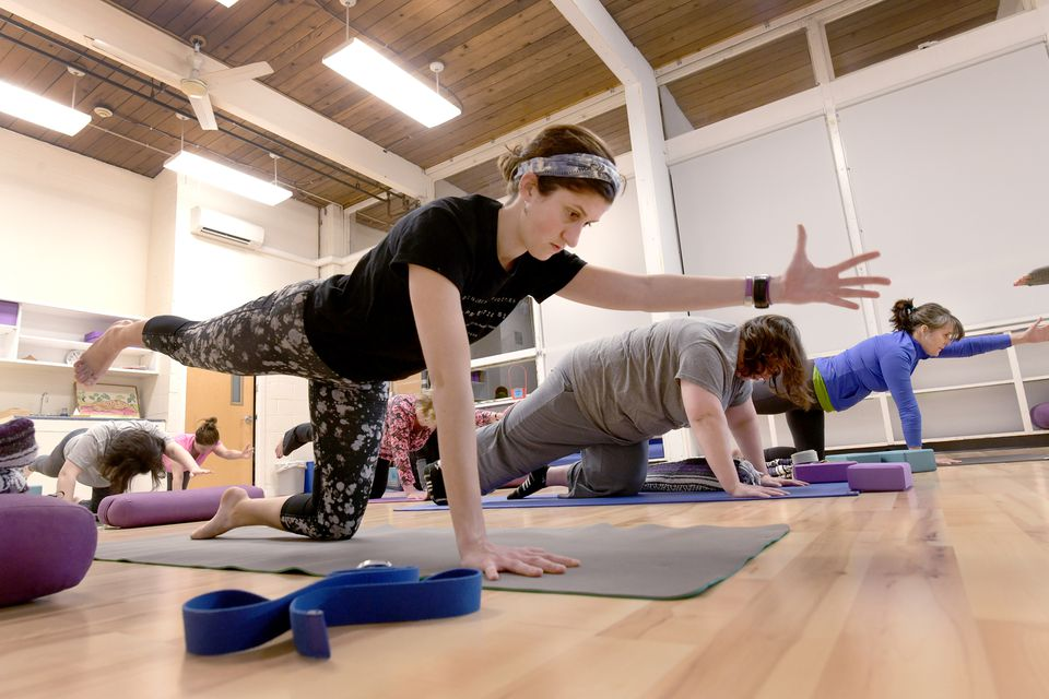 """Lizzy Handschy held a position in Yoga for Sustainable Activism. """"If you ... aren't stopping and pausing and practicing self-care, you will burn out,'' said instructor Katie Beane."""